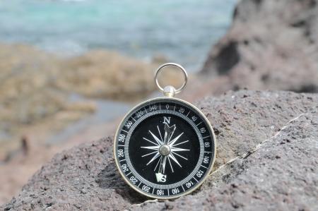 One Compass on the Rocks near the Atlantic Ocean Stock Photo - 22813261