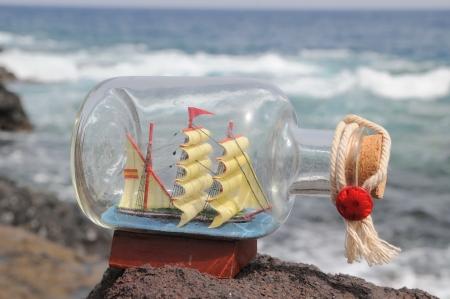 Sailing Ship in the Bottle near the Ocean photo