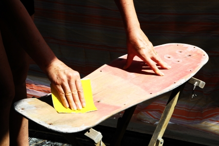 Restore an Old Skateboard with a Yellow Sandpaper photo