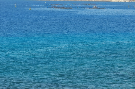 Fish Farm in the Atlantic Ocean on a Blue Day photo
