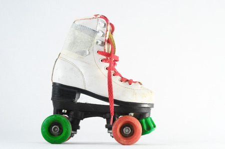 roller skating: Used Vintage Consumed Roller Skate on a White Background
