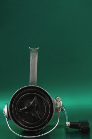 One Vintage Old Fishing Reel on a Colored Background Stock Photo - 22913111