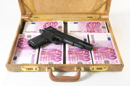 One Suitcase Full of Pink 500 Euros Banknotes and a Gun  photo