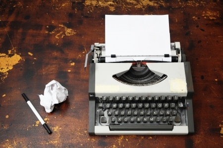 Old Vintage Travel Typewriter on a Brown Wooden Table Stock Photo - 22942796