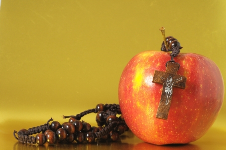 Bible Eva's Sin Red Apple over a Colored Background photo