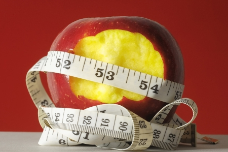 Diet Apple and Meter on a Colored Background  photo