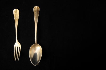 Ancient Vintage Silver  Flatware on a Black  Stock Photo - 23164892