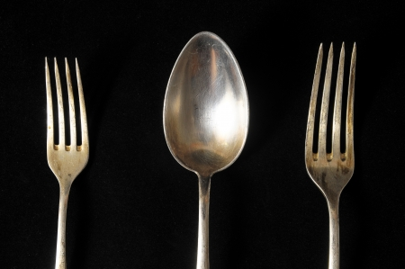 Ancient Vintage Silver  Flatware on a Black  Stock Photo - 23164899