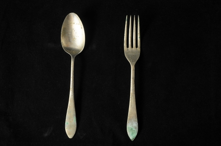 Ancient Vintage Silver   Flatware on a Black  photo