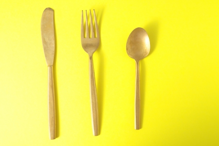 silver flatware: Ancient Vintage Silver   Flatware on a Colored  Stock Photo