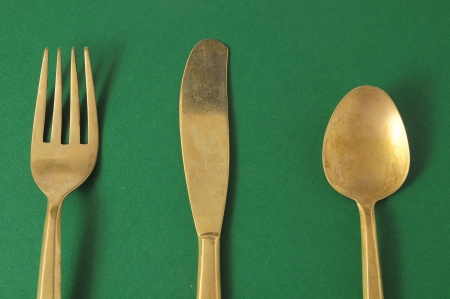 Ancient Vintage Silver  Flatware on a Colored  Stock Photo - 23158243