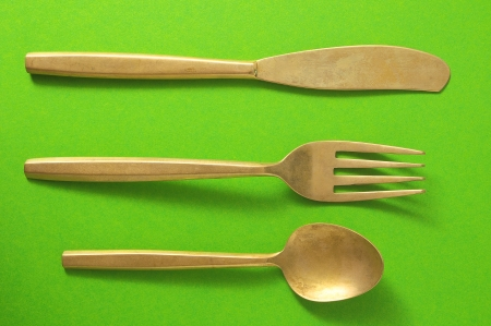 silver flatware: Ancient Vintage Silver   Flatware on a Colored Background