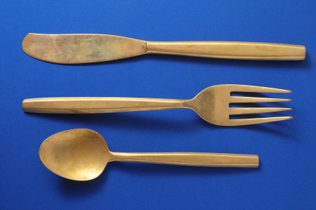 Ancient Vintage Silver  Flatware on a Colored  Stock Photo - 23158246