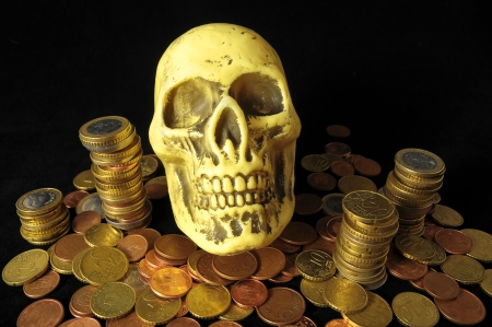 Death and Money Concept Skull and Currency over a Black  photo