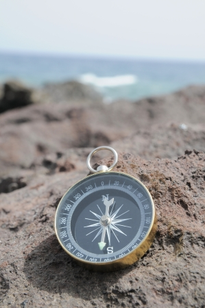 One Compass on the Rocks near the Atlantic Ocean Stock Photo - 23165917