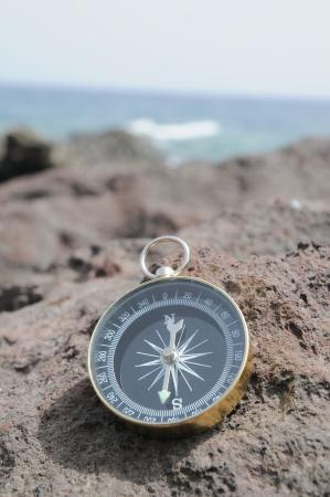 One Compass on the Rocks near the Atlantic Ocean Stock Photo - 23165917