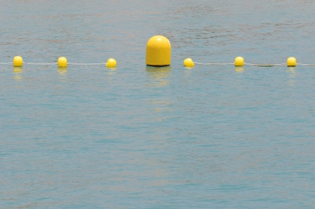 floaters: Some Yellow Floaters over the Blue of the Atlantic Ocean Stock Photo