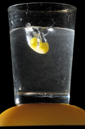 Healthy Food Italian Pasta Splashing in Water over a Black Background photo