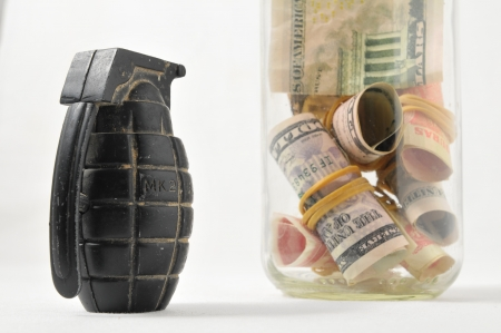 Money for War Concept Hand Grenade and Money Stock Photo - 23336954