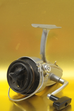 One Vintage Old Fishing Reel on a Colored Background Stock Photo - 23381869