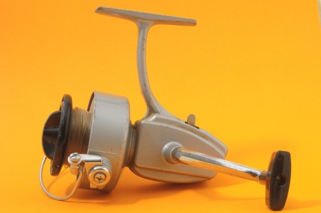 One Vintage Old Fishing Reel on a Colored Background Stock Photo - 23381870