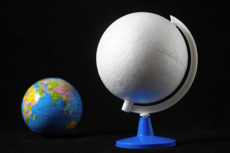 Many Globes Planet Earth on a Black Background Stock Photo - 23381935
