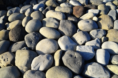 Texture of Round Rocks Smoothed by the Water photo