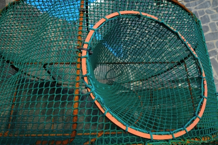 Empty Green Net Fish Traps on a Pier photo