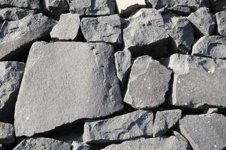 rockwall: Texture Gray Rock Ancient Wall made of Volcanic Rocks