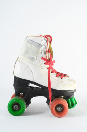 Used Vintage Consumed Roller Skate on a White Background photo