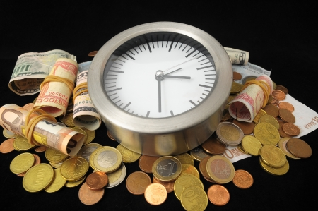 Time is Money Concept a Clock and Currency photo