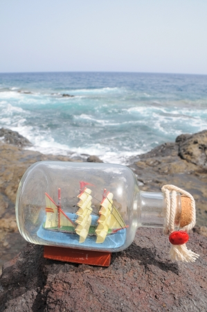 Sailing Ship in a Bottle near the Ocean photo