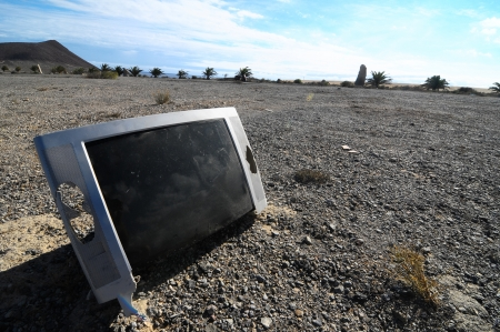 Old Broken Gray Television Abandoned in the Desert photo