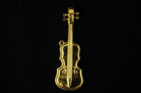 Gold Violin Instrument Figurine on a Colored Background photo