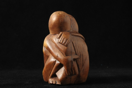 Lovers Sculpture made of Wood on a Black  photo