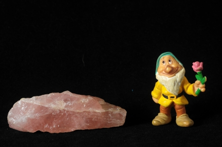 Dwarf and Semiprecious Stone on a Black Background photo