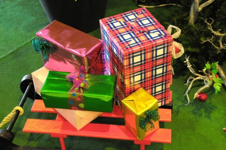Stack of Christmas gifts with ribbon and bow photo