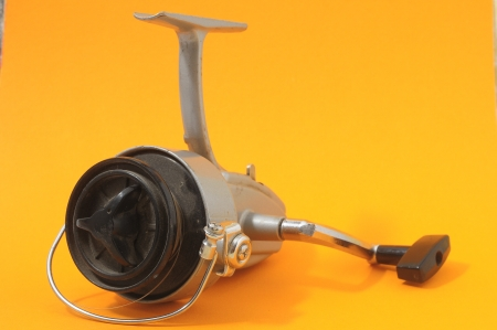 One Vintage Old Fishing Reel on a Colored Background Stock Photo - 24620137