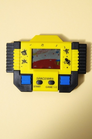 One Old Yellow Vintage Videogame with four Buttons