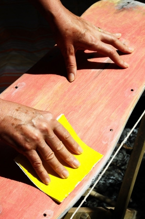 sanding block: Restore an Old Skateboard with a Yellow Sandpaper Stock Photo