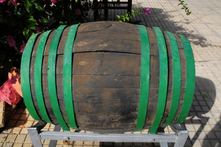 Decorative Old Wooden Barrel on an Urban Garden photo