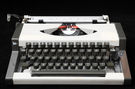 An Old Travel Vintage Typewriter on a Black Background photo
