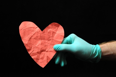 Heart And an Hand on a Black Background photo