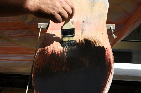 Restore an Old Vintage Skateboard with Black Painting photo