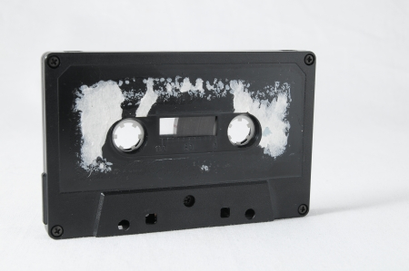 disuse: Ancient Vintage Used Music cassette over a White