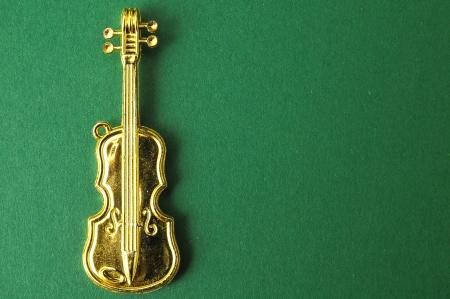 Gold Violin Instrument Figurine photo