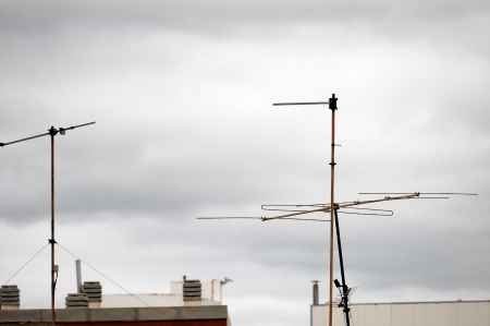 Antennas on a Roof over cloudy Sky, in Canary Islands, Spain photo