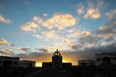 Abandoned Buildings of a Military Base at Sunset photo