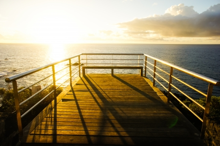 Sunrise on a Pier over Atlantic Ocean in Tenerife Canary Islands Spain