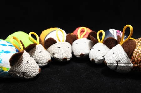 Toy Mouse Made of Cotton Cloth on a Black Background photo